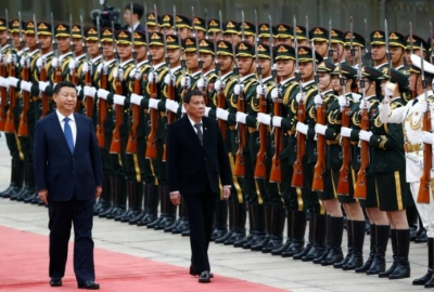 President of the Philippines Rodrigo Duterte and Chinese President Xi Jinping review the guard of honor as they attend a welcoming ceremony at the Great Hall of the People in Beijing, China, October 20, 2016. REUTERS/Thomas Peter